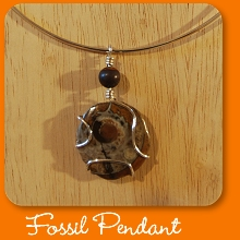 Ammonite fossil pendant with sterling silver neck wire